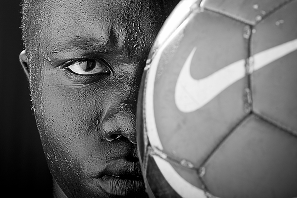 Soccer Photograph - Tough Like A Nike Ball by Val Black Russian Tourchin
