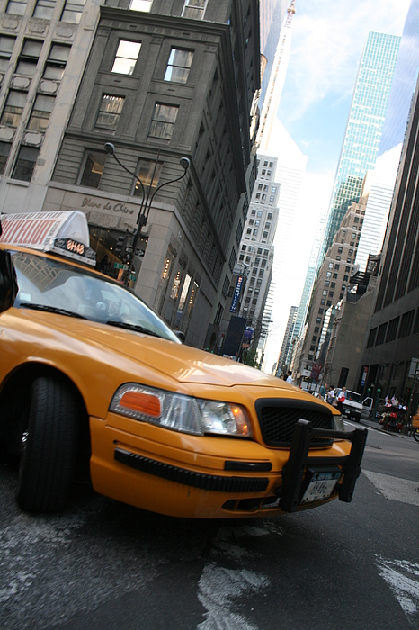 Taxi Photograph - Turning Taxi by Jeff Porter