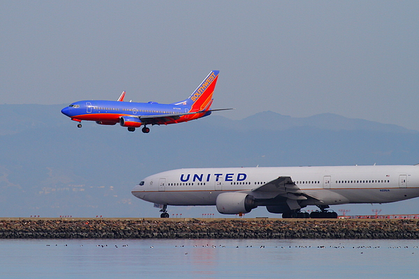 Southwest Photograph - United Airlines And Southwest Airlines Jet Airplane At San Francisco International Airport Sfo.12087 by Wingsdomain Art and Photography