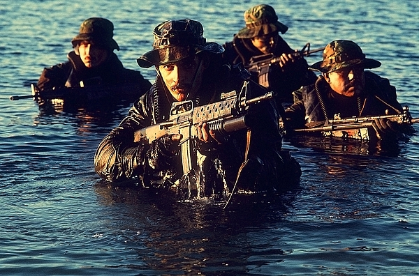 History Photograph - Us Navy Seal Team Emerges From Water by Everett