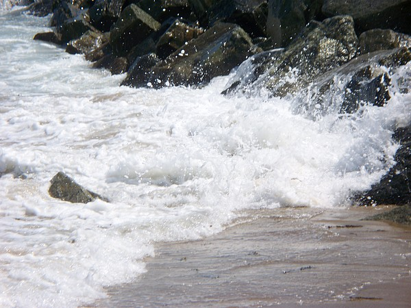 Seascape Photograph - waves lapping at the rocks III by Rosanne Bartlett