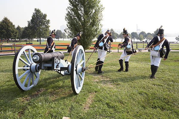 Baltimore Photograph - Wheeling The Cannon At Fort Mchenry In Baltimore Maryland by William Kuta