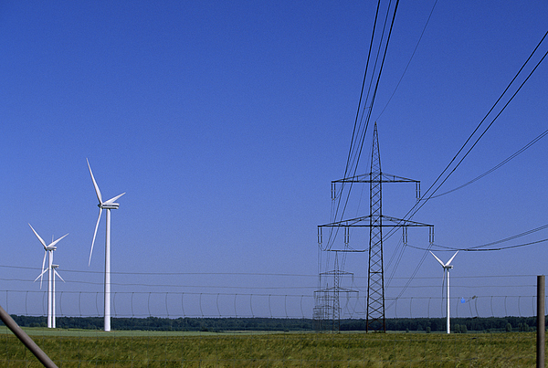 Mecklenburg-vorpommern Photograph - Windmills And High Voltage Transmission by Norbert Rosing