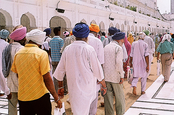 Digital Photograph Photograph - Worshippers At Golden Temple Amritsar India -2 by Padmakar Kappagantula