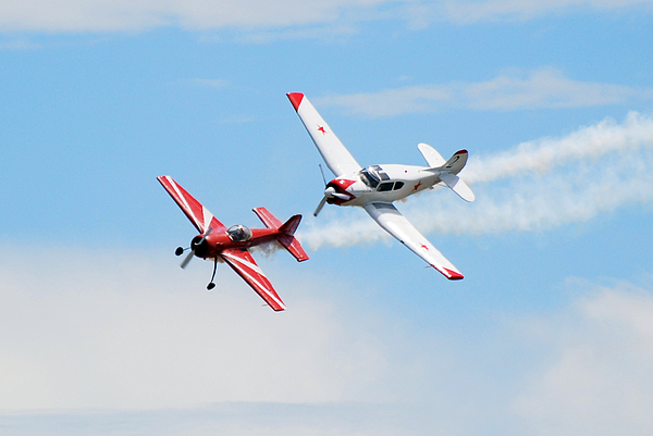 Airplanes Photograph - Yak 55 And Yak 18 by Larry Keahey