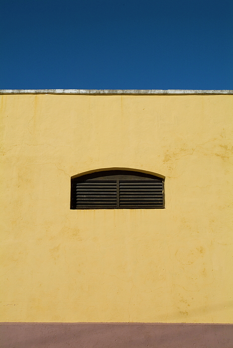 Blue Sky Photograph - Yellow Wall In Trinidad by Sami Sarkis