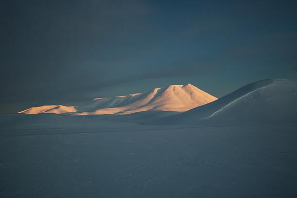 A mountain lit by sunrise. Photograph by Alex Saberi