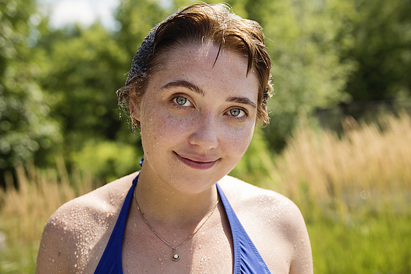 Beautiful portrait of young woman in summer nature. Photograph by Martinedoucet