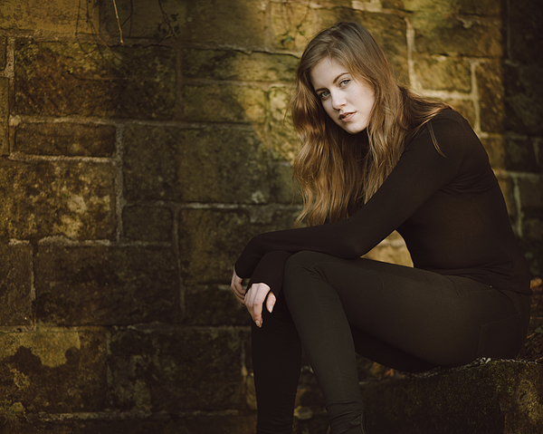 Beautiful young woman in black Photograph by Theasis