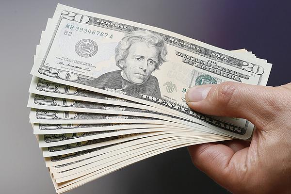 Businessman Holding US Dollars Photograph by Thomas Trutschel