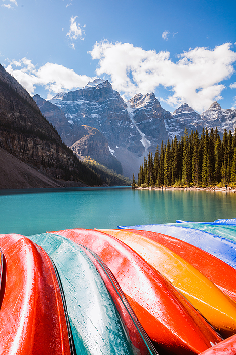 Canoes at Moraine lake, Banff National Park, Canada Photograph by Matteo Colombo