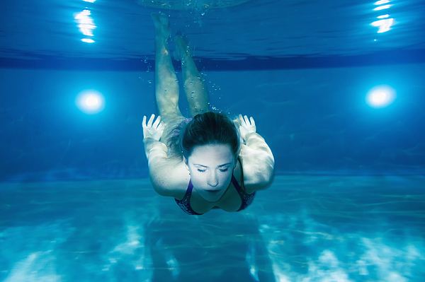 Caucasian woman swimming underwater in pool Photograph by Jacobs Stock Photography Ltd