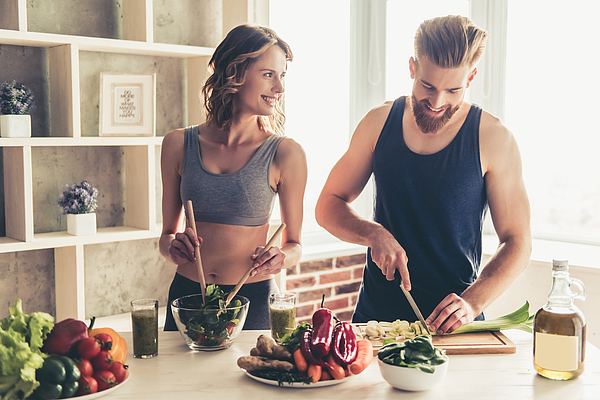 Couple cooking healthy food Photograph by GeorgeRudy