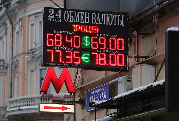Currency Exchange And City Retail As EU Prepares Tougher Russian Penalties Photograph by Bloomberg