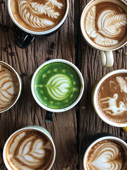 Directly Above Shot Of Coffee With Froth Art On Table Photograph by Pakorn Polachai / EyeEm
