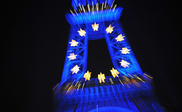 Eiffel Tower Projects EU Flag As France Assumes Union Presidency Photograph by Pascal Le Segretain