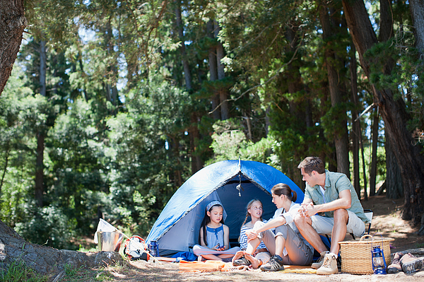 Family camping Photograph by Tom Merton