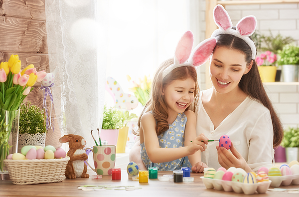 family preparing for Easter Photograph by Choreograph