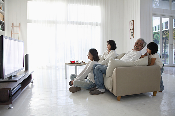 Family watching television Photograph by Ultra.f