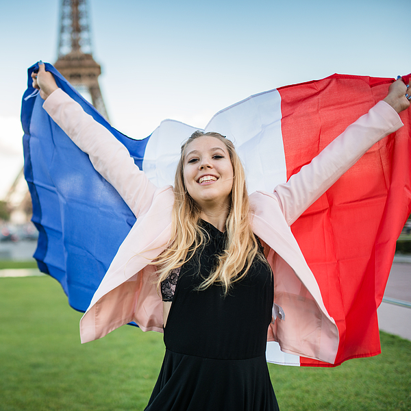 freedom tourist in paris against the tour Eiffel Photograph by Franckreporter