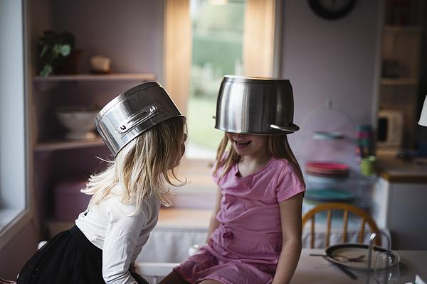 Girls wearing pots Photograph by Johner Images