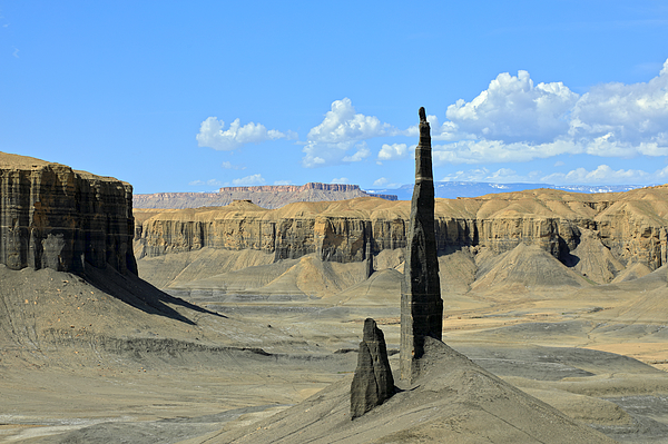 High and thin rock needles in a desert landscape Photograph by Rainer Grosskopf
