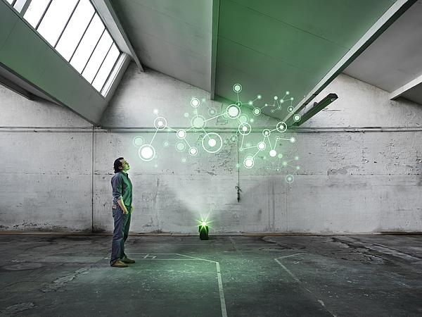 Hologram in warehouse Photograph by Henrik Sorensen