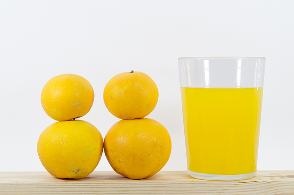 How many oranges do you need to make a glass of orange juice? Photograph by Luis Diaz Devesa