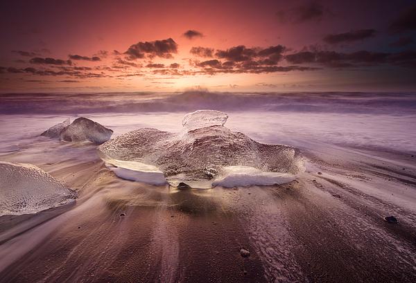 Icebergs on a beach at sunrise. Photograph by Alex Saberi