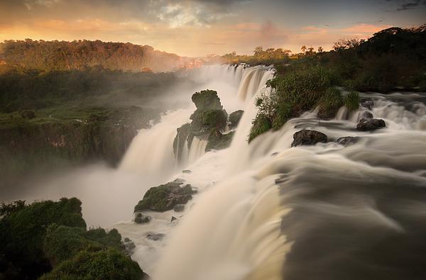 Iguazu falls waterfalls at sunset. Photograph by Alex Saberi