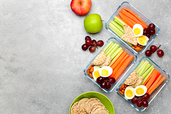 Lunch boxes with healthy snacks, overhead view Photograph by Fortyforks