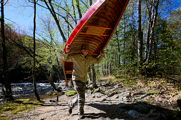Man camping at the riverbank with a canoe Photograph by Max shen
