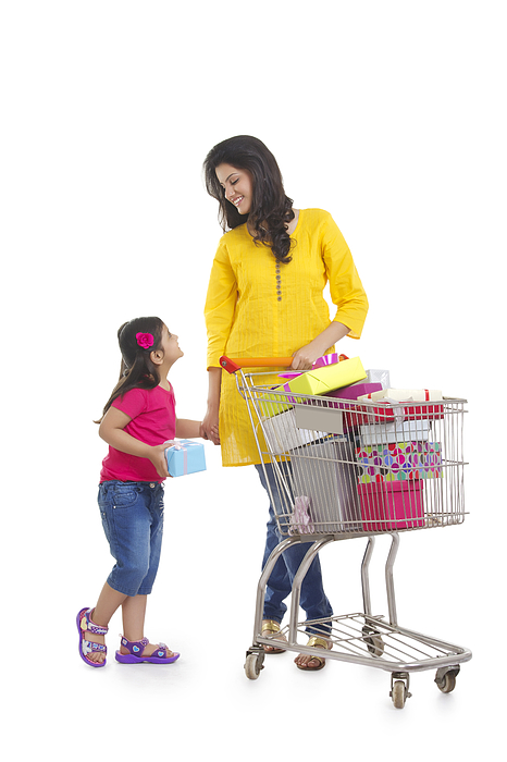 Mother and daughter with gifts in shopping cart Photograph by Sudipta Halder