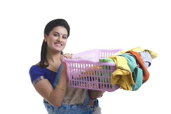 Portrait of a housewife holding a laundry basket Photograph by Sudipta Halder