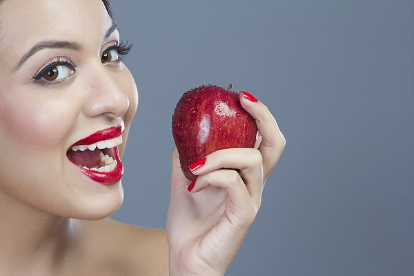 Portrait of a woman holding an apple Photograph by Sudipta Halder