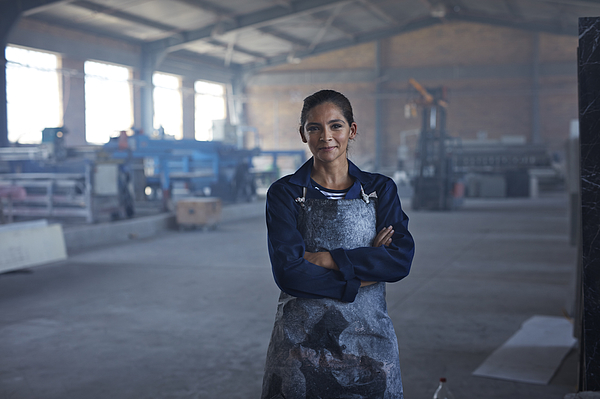 Portrait of female worker at factory Photograph by Klaus Vedfelt