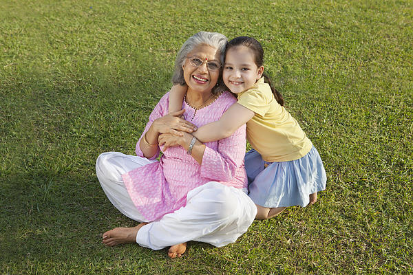 Portrait of grandmother and granddaughter smiling Photograph by Ravi Ranjan