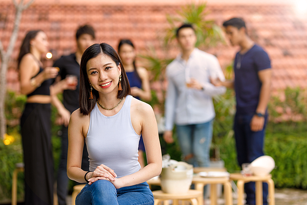 Portrait Of Young Asian Woman At Outdoor Roof Top Party With Friends Photograph by Thurtell
