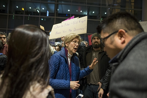 Protestors Rally At Bostons Logan Airport Against Muslim Immigration Ban Photograph by Scott Eisen