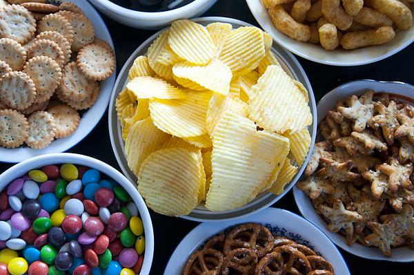 Salty snacks Photograph by Carotur