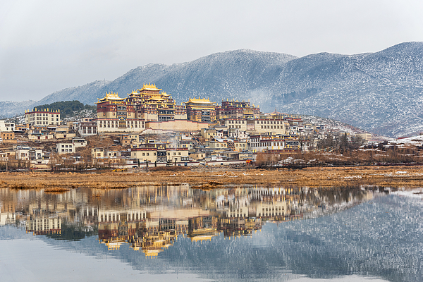 Songzanlin Temple also known as the Ganden Sumtseling Monastery, is a Tibetan Buddhist monastery in Zhongdian city( Shangri-La), Yunnan province China and is closely Potala Palace in Lhasa Photograph by Suttipong Sutiratanachai