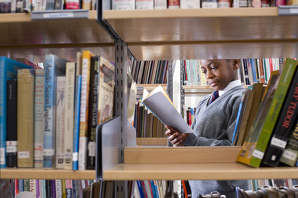 Student In Library Photograph by David Leahy