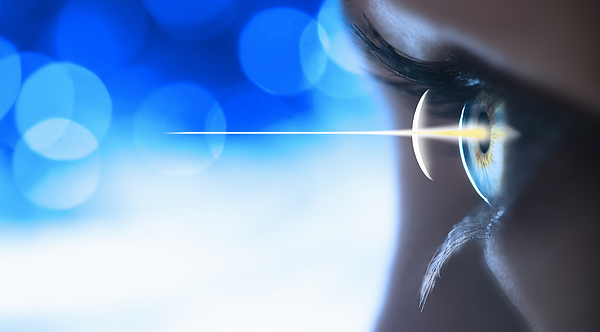 Studio Shot Of Light Beam Coming From Eye Photograph by Tetra Images