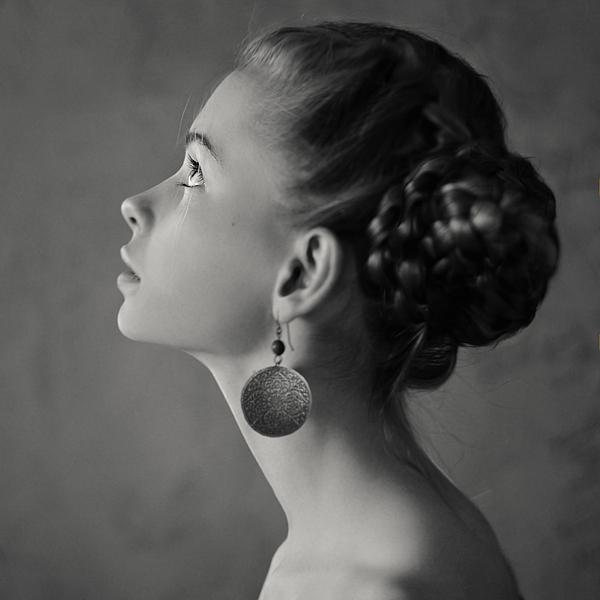 Teenage girl with braided hair wearing dangling earrings Photograph by Vladimir Serov