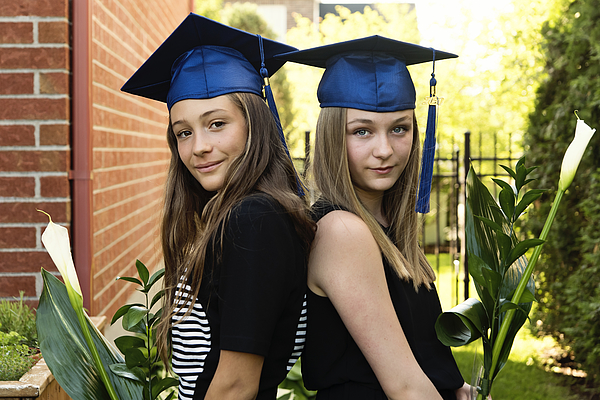 Teenage girls graduation from primary school portrait in backyard. Photograph by Martinedoucet