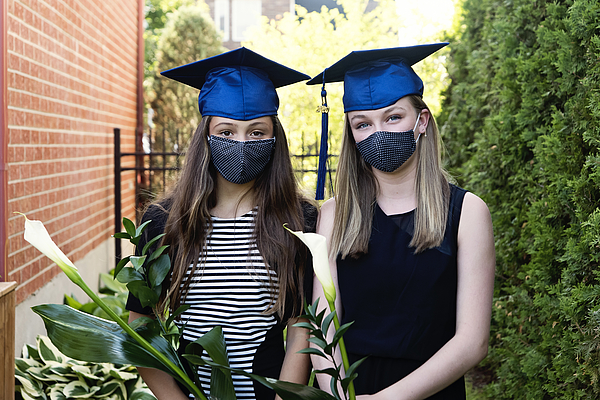 Teenage girls graduation from primary school portrait with protective mask. Photograph by Martinedoucet