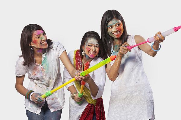 Three women playing holi Photograph by Hemant Mehta