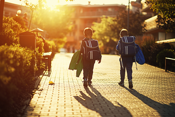 Two little boys returning from school Photograph by Imgorthand