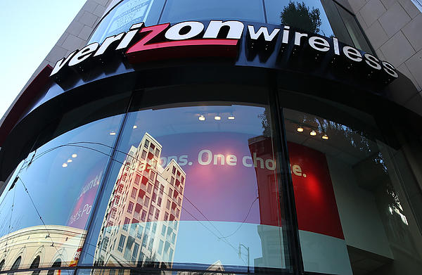 Verizon Reports Drop In Fourth Quarter Earnings Photograph by Justin Sullivan