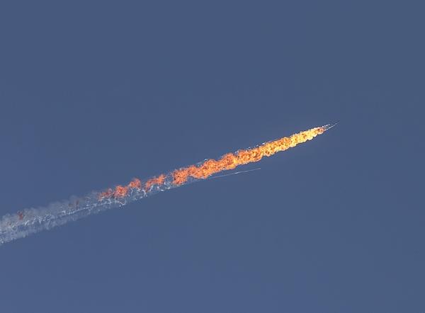 Warplane crashes in Syria near Turkeys border Photograph by Anadolu Agency